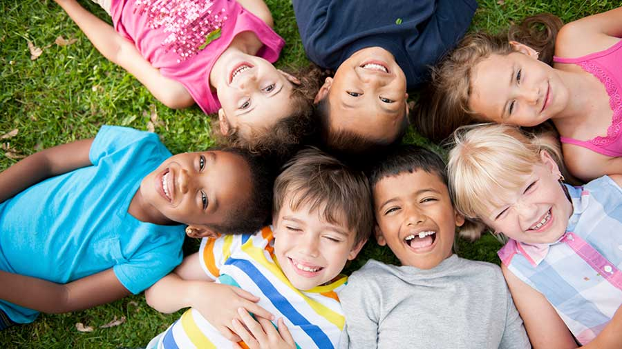 Group of children laying in grass